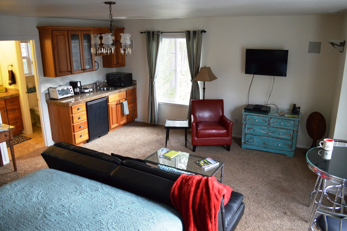 Homey living area with TV, kitchenette, and private bath. Coffee maker, fridge, microwave, hot plate and toaster oven.