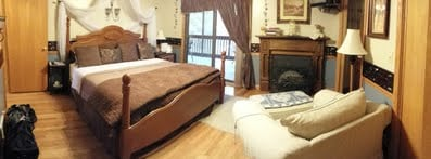Your Junior Jacuzzi Suite awaits your arrival with double occupancy.  This beautiful suite offers a King Size Bed with an electric fireplace to add romance to your stay.