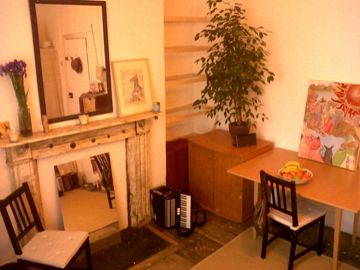 Fireplace, table and built in shelves