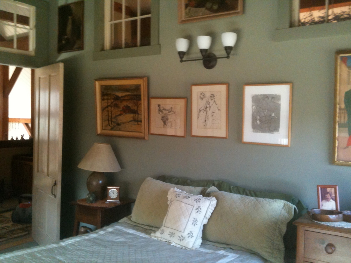 Your room with double bed antiques and art.