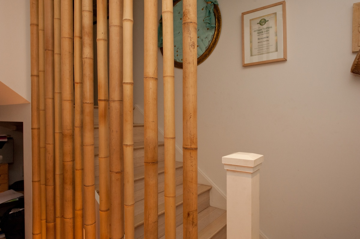 Bamboo balustrade up to the yoga room