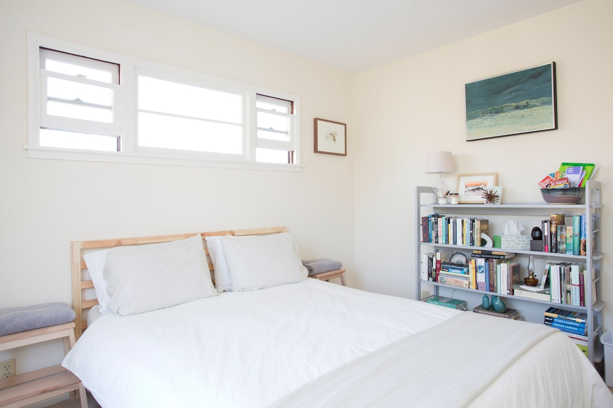 Comfy bed with a selection of books to choose from