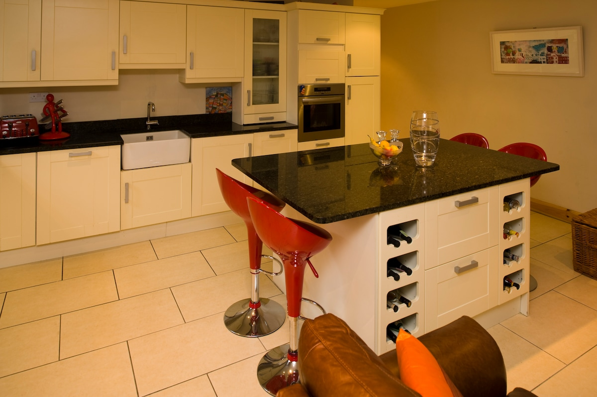 The kitchen island, which holds the fridge and freezer well hidden...
