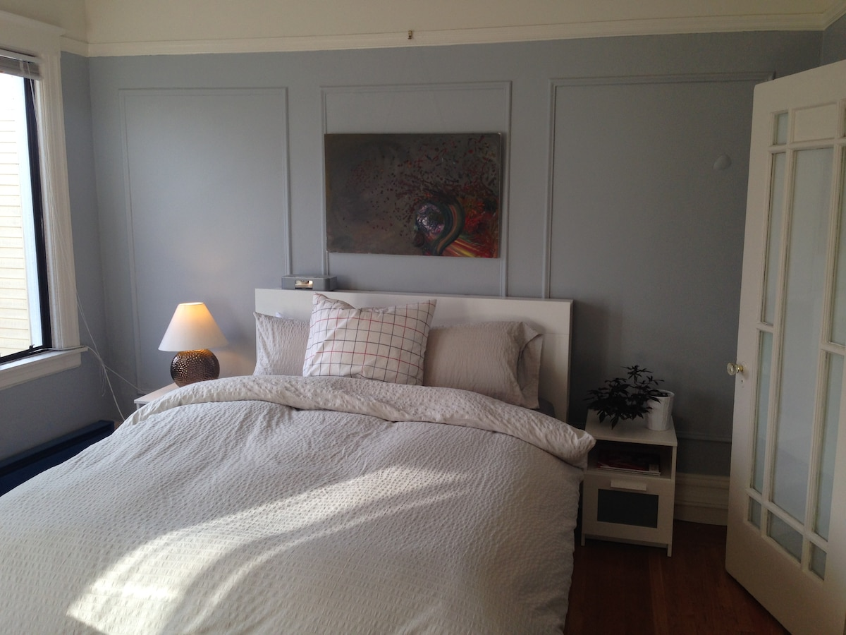 Recently repainted bedroom in a warm and bright grey. New duvet, linens and furnishings recently added