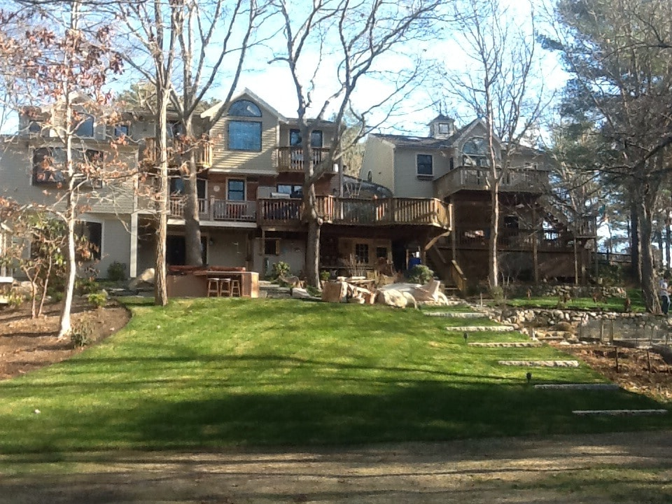 View of back yard.  Guest apt. is above the detached garage on the right of house
