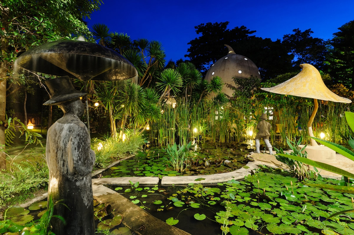 The magical garden and pond at night.
