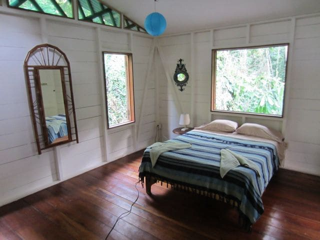 Jungle views out of every window of the cozy and spacious master bedroom