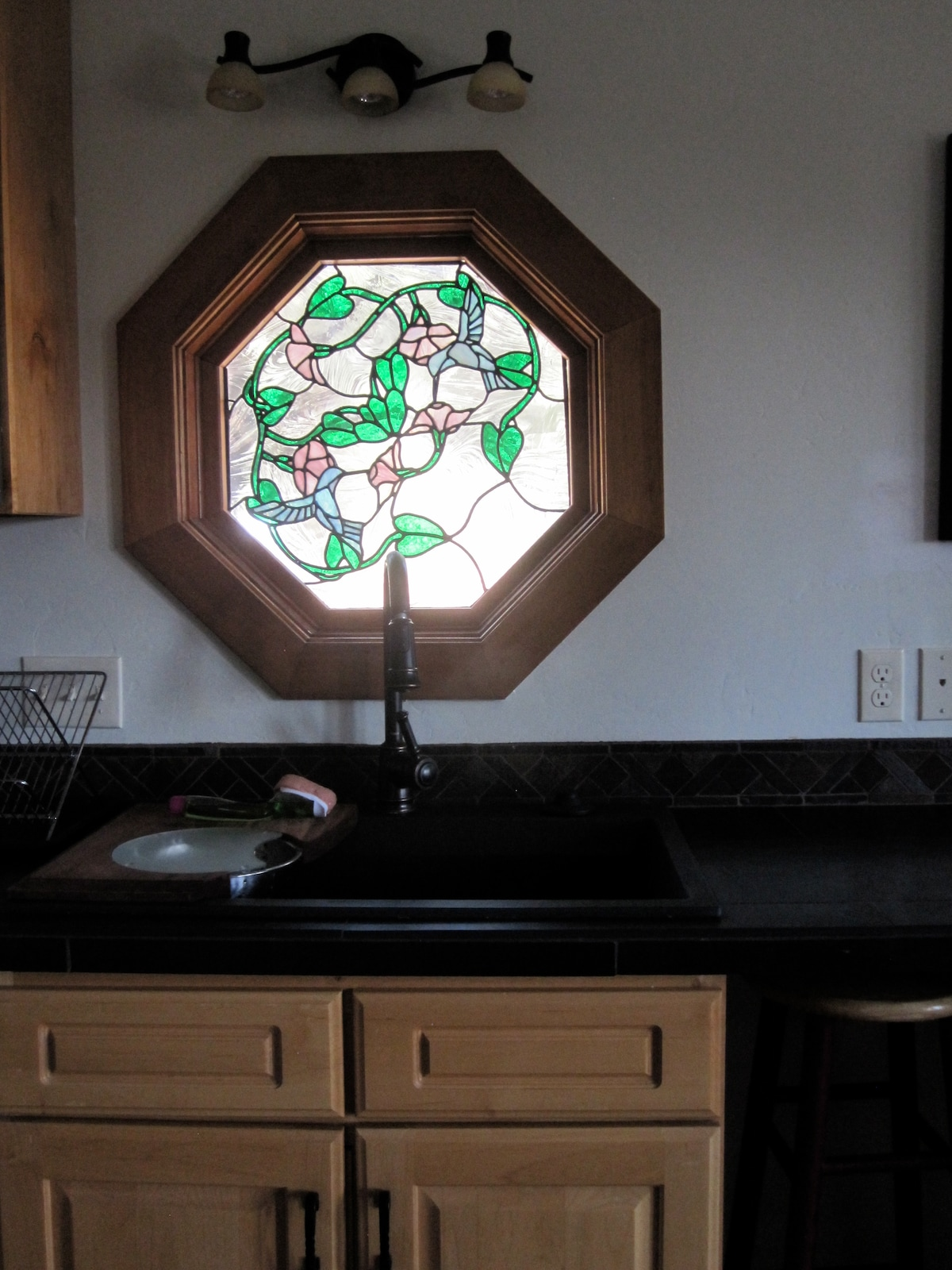 New concrete sink, custom stained glass.