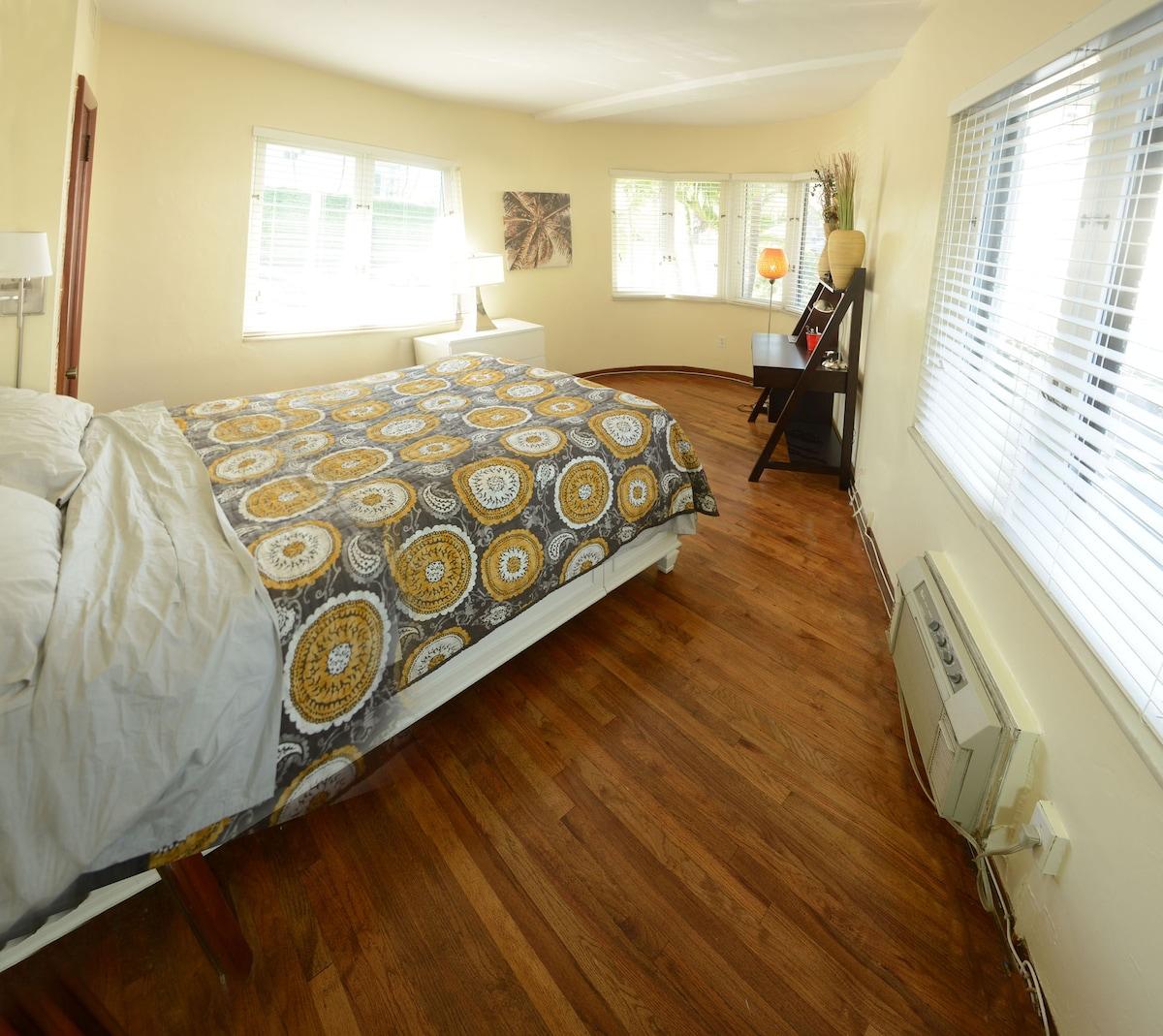 "Bedroom with unique ""flat iron"" floor layout"