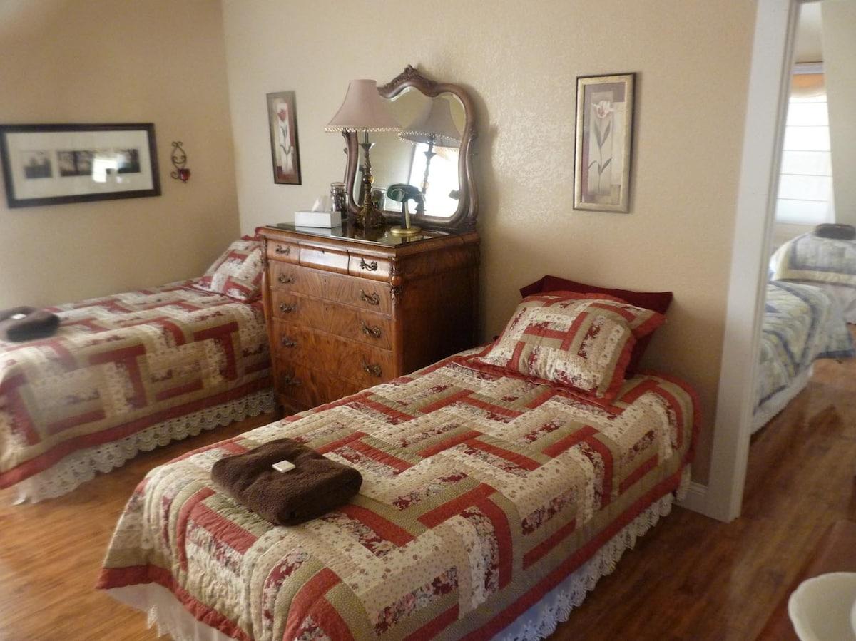 East bedroom, 3 beds, antique dresser