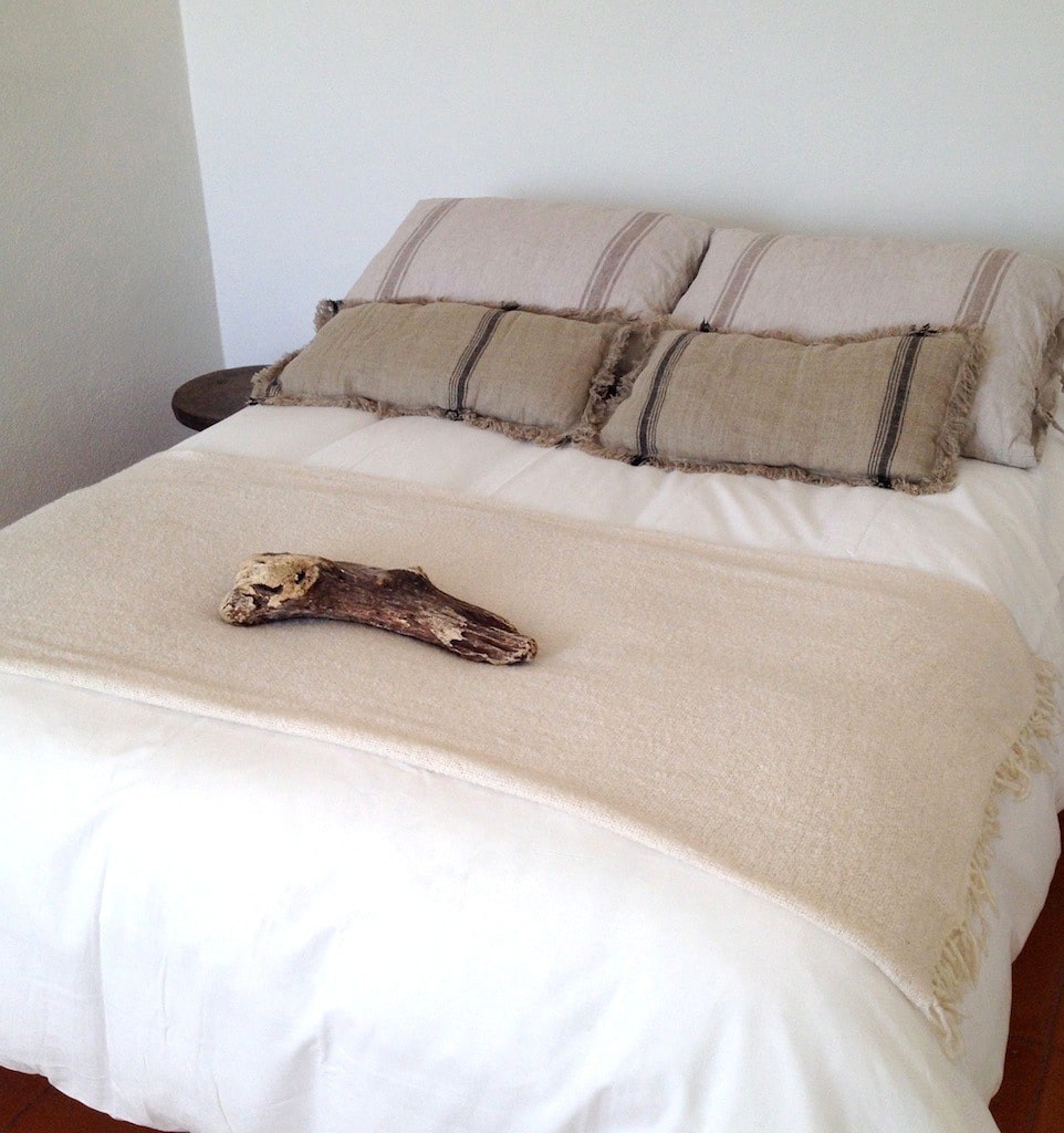 COMFORTABLE BED WITH DESIGNER LINENS AND DUVET COVER