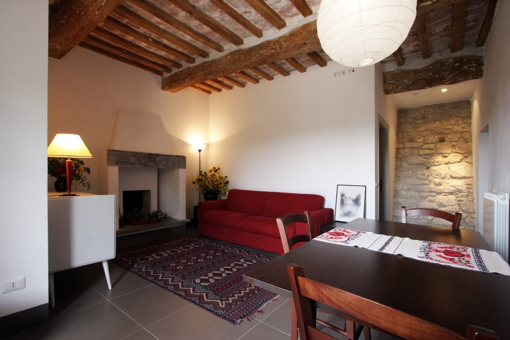 The living room with its old fireplace and the Tower's wall at the bottom