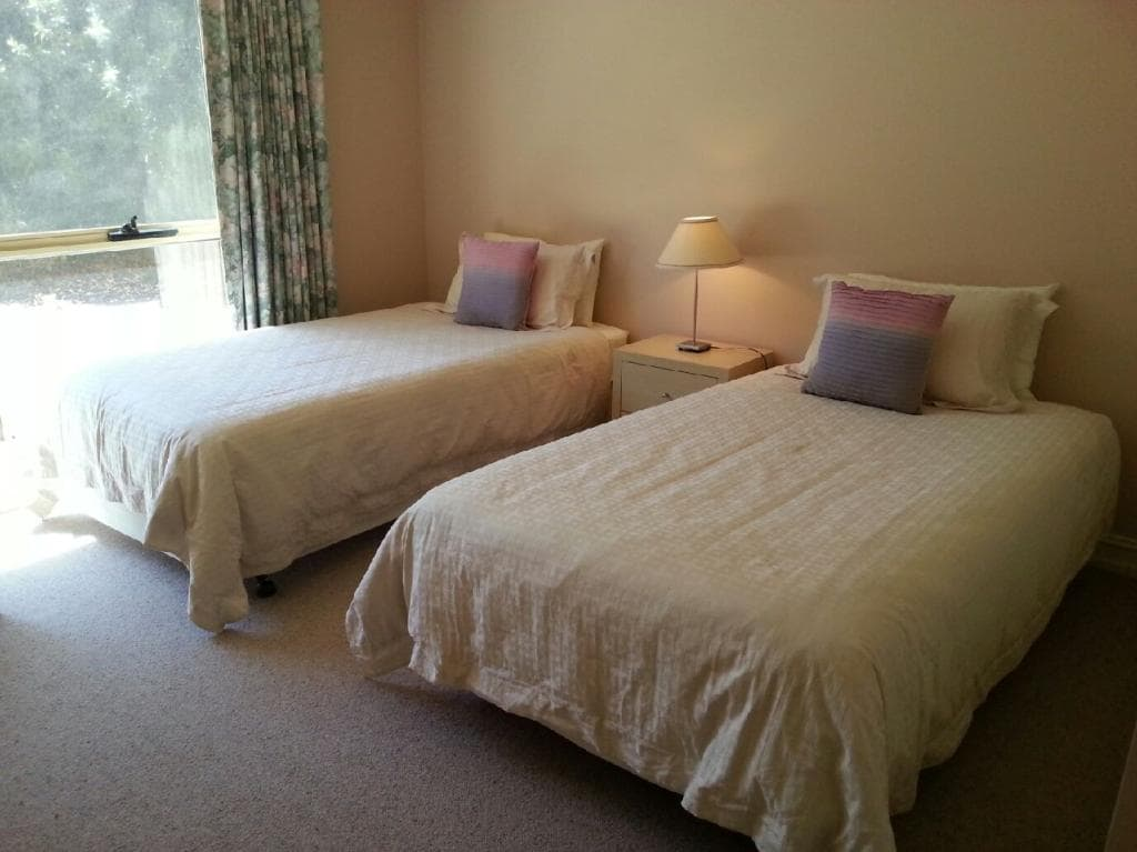 Two king size single beds with built in wardrobes, carpet.
