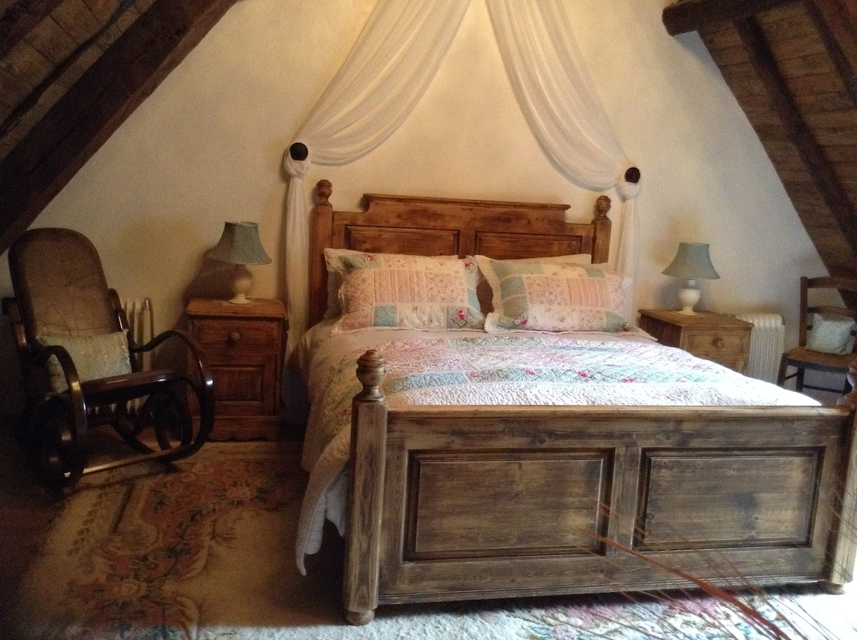 Large Master bedroom, with stunning views over the mountains.  All the ceiling has been lovingly restored. Exposed beams. En suite with shower.