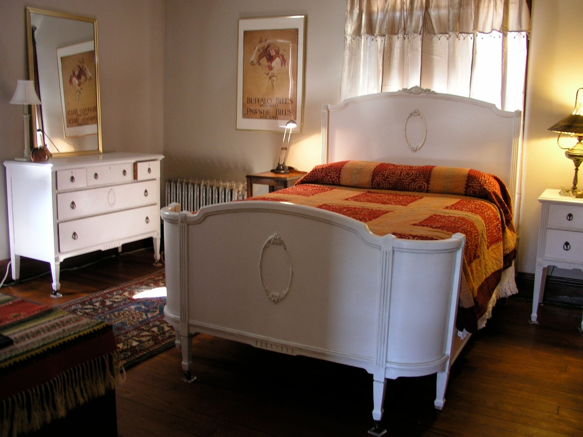 Beautiful antique bed and modern mattress.   A winning combo for a good nights rest.