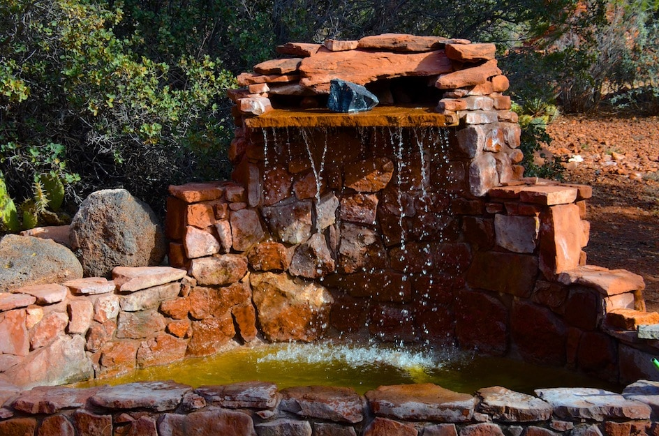 The front entrance waterfall with Sacred waters in it from all around Mother Earth.