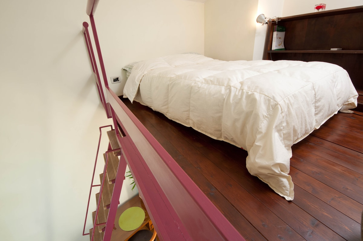 queen-size bed on the room loft