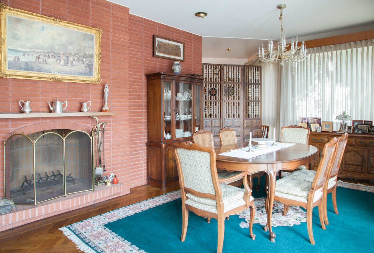 The formal dining room by the fireplace...there are few nights along the Bay when a fire isn't welcome.