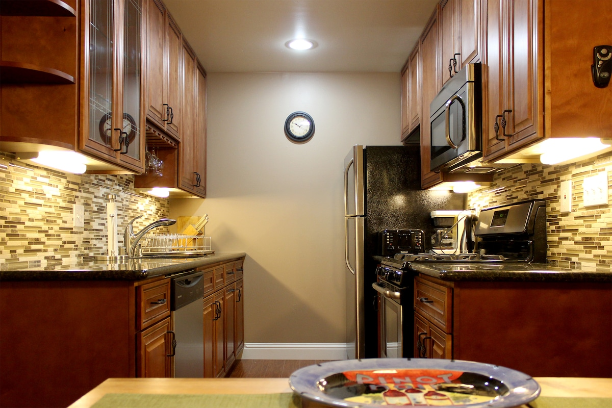 Kitchen with new stainless steel appliances.
