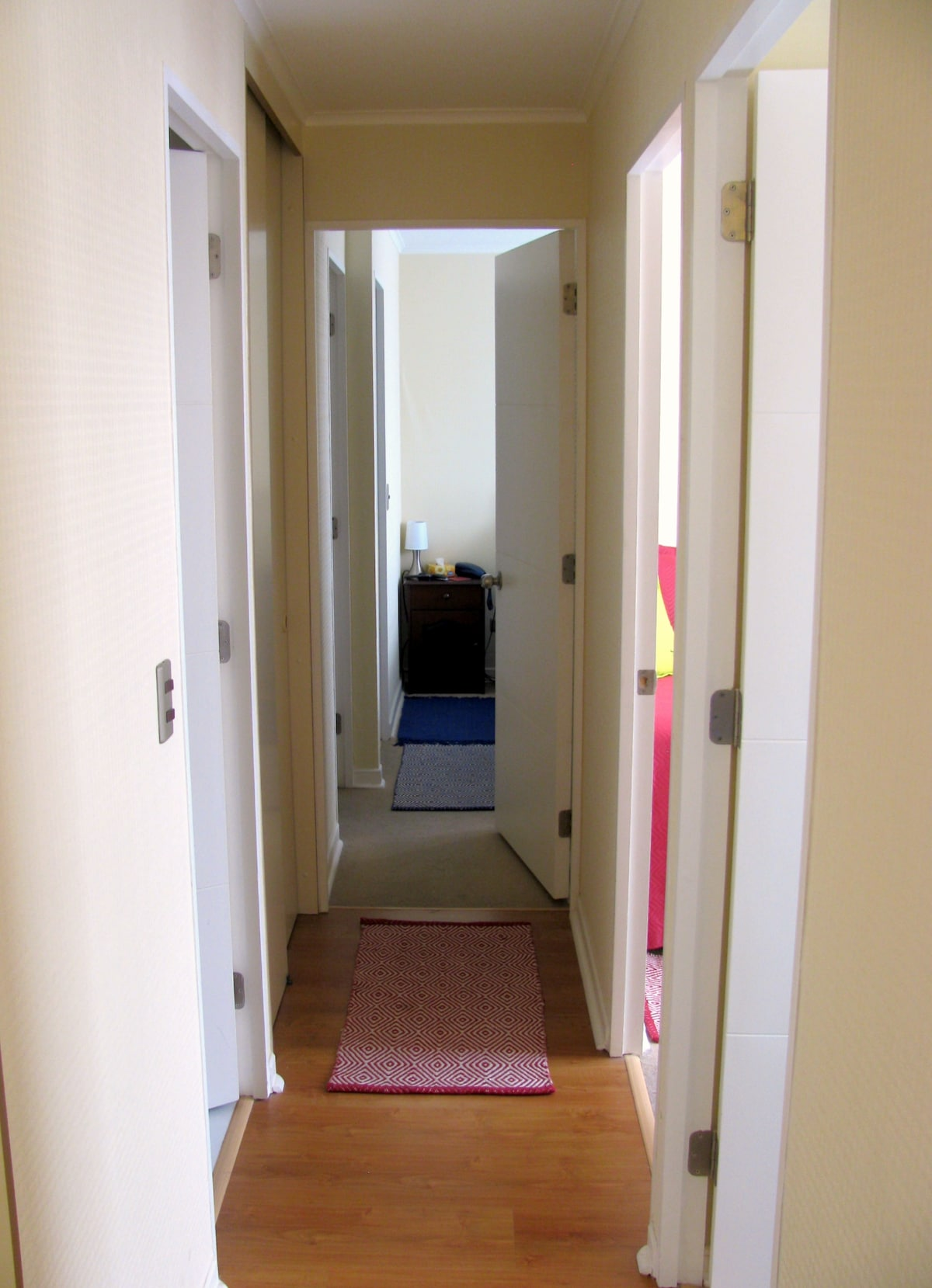 Hallway that leads to 3 bedrooms and 2 bathrooms