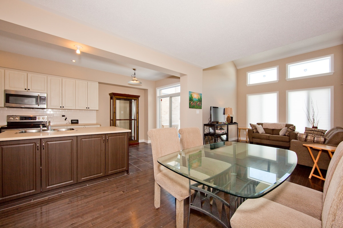 Open concept living, kitchen and dining rooms.
