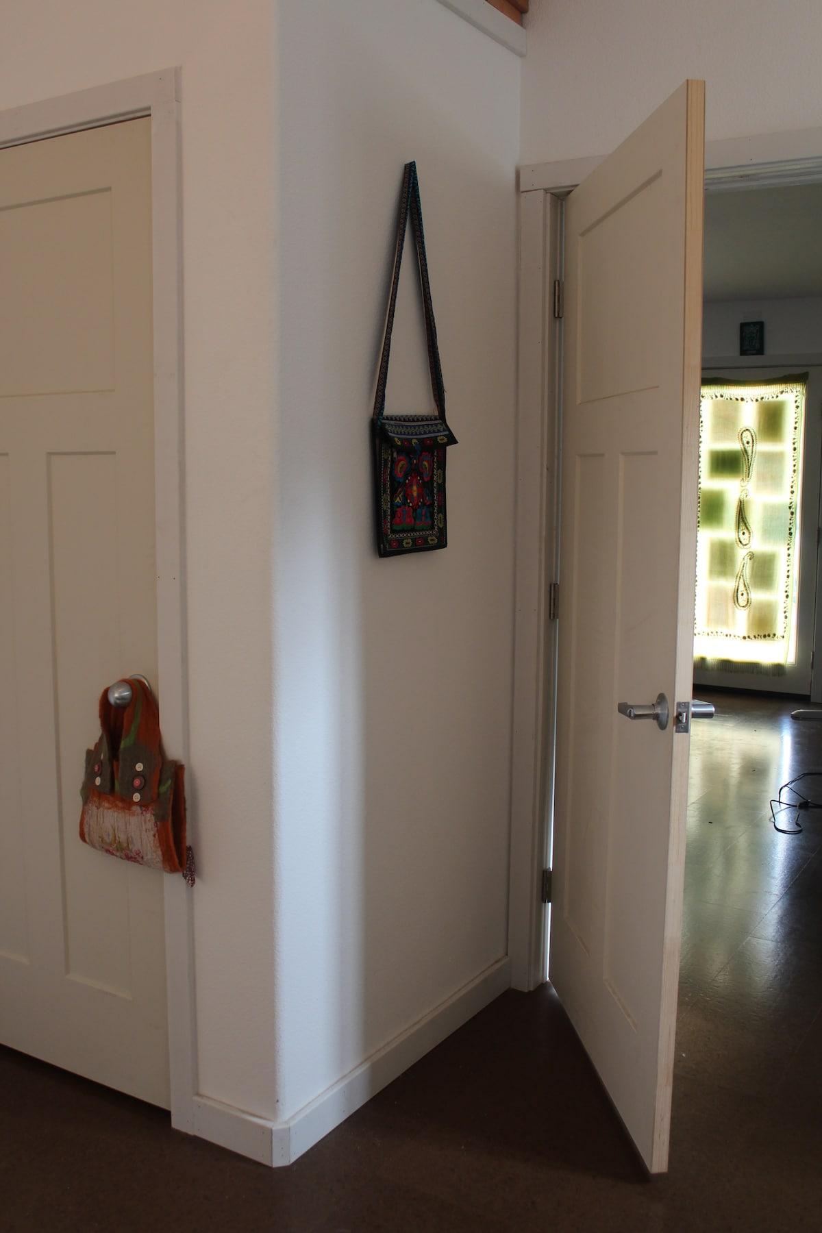 view of closet and front door