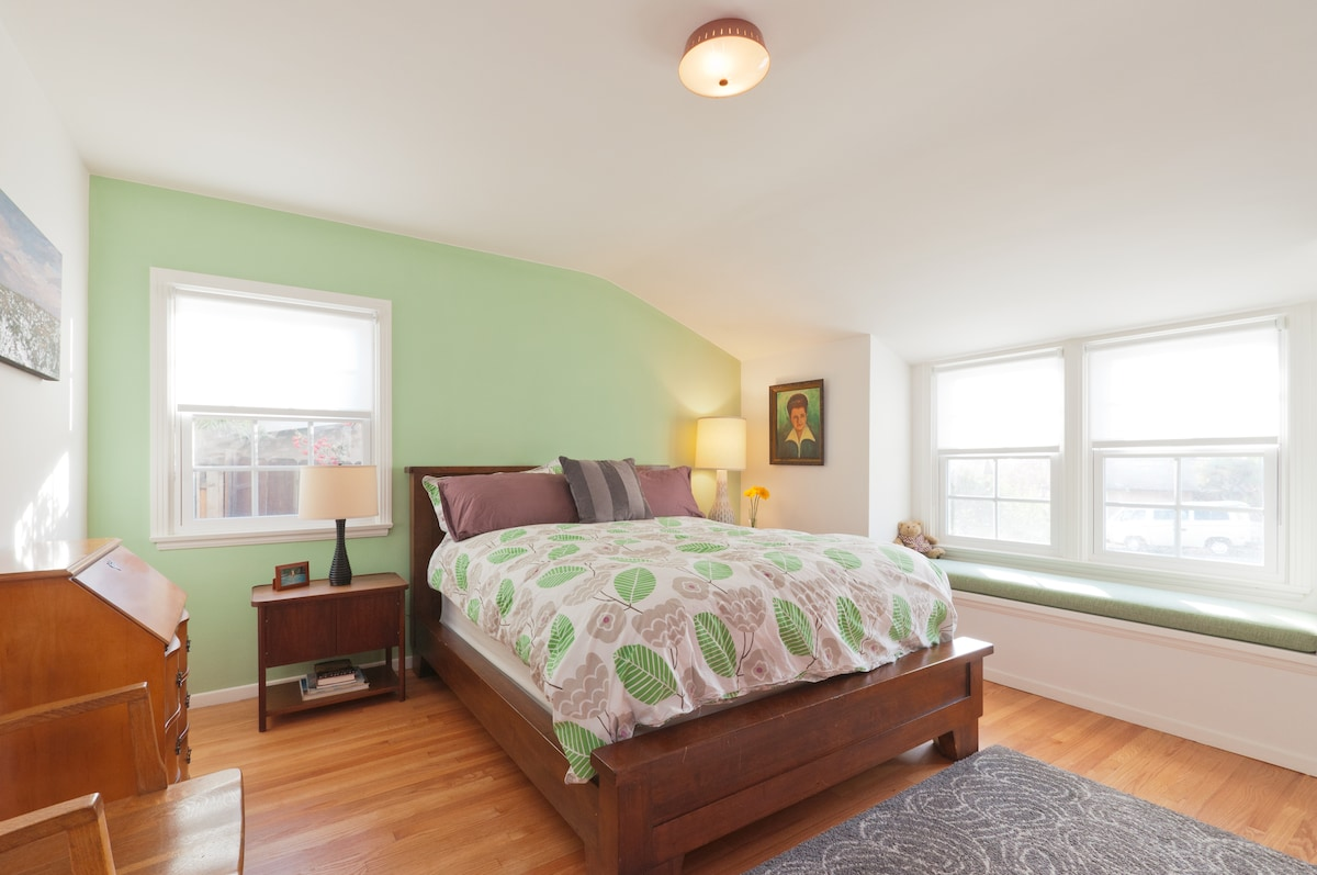 Guest Bedroom features very comfortable queen bed and television.