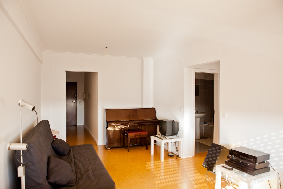 Living/Dining Room featuring Piano, TV/DVD set, sofa/bed