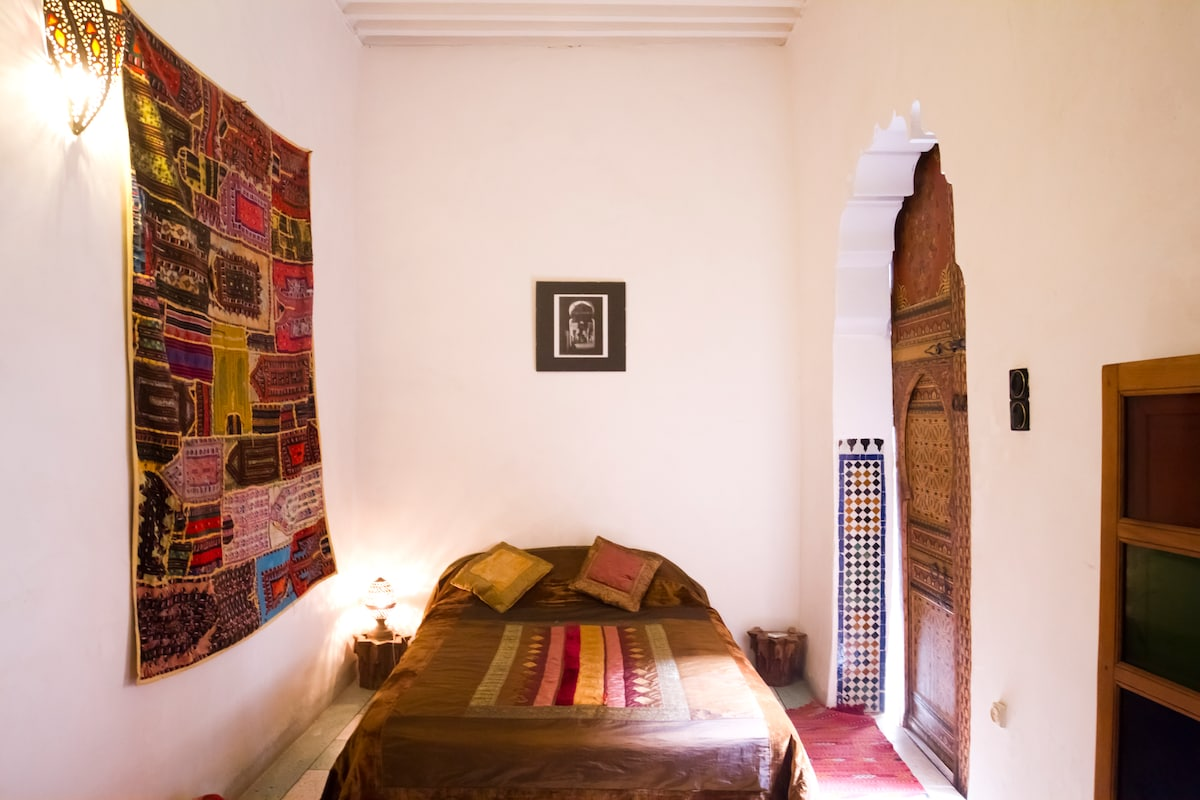 Note the hand cut zillige tiles, and the artisan made brass bedside lamp.