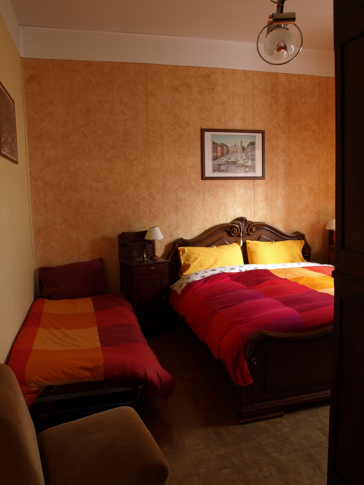 The room by our wood pile can easily accommodate an extra bed