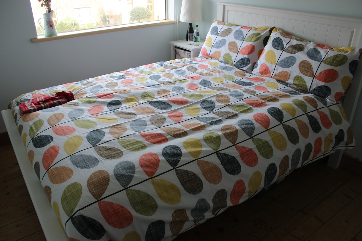 Comfortable new double bed with luxurious bed linen