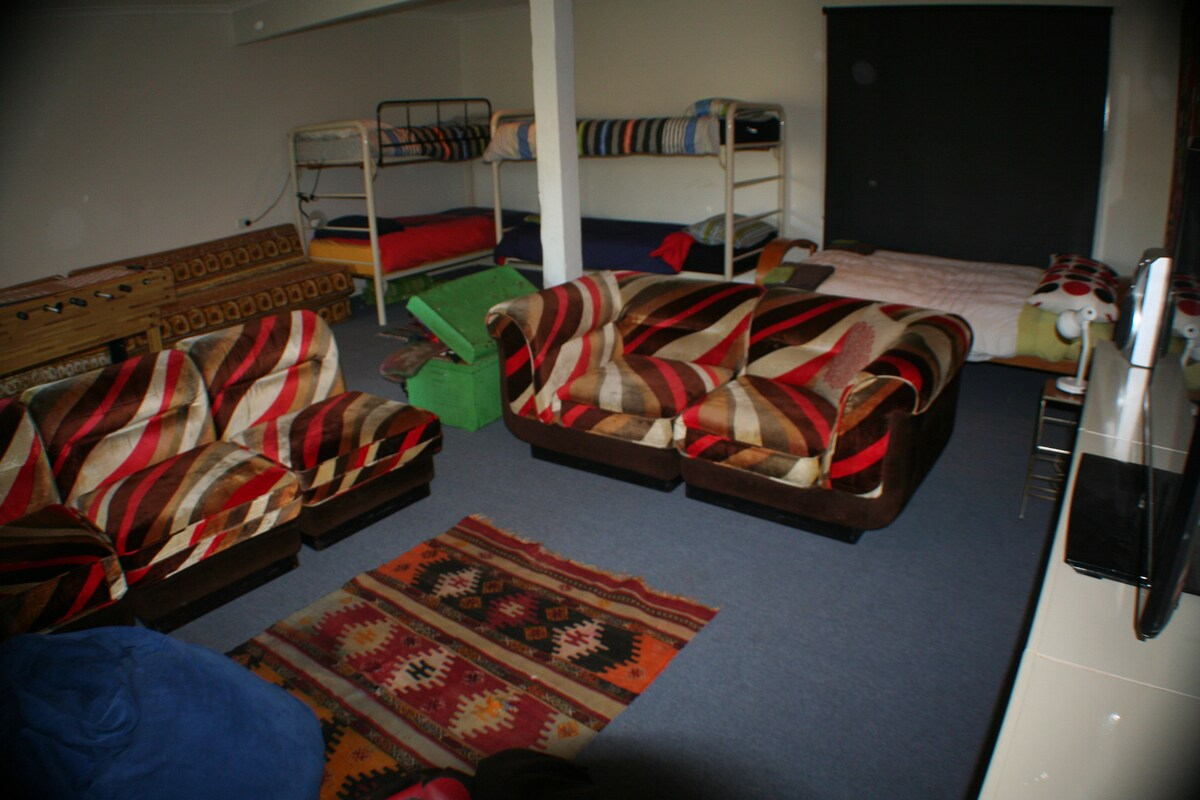 downstairs rumpus room with dress up box, games, tv etc