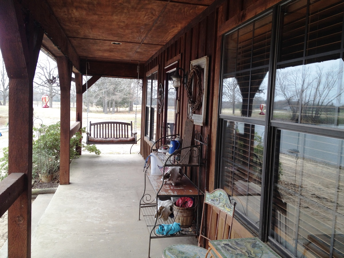 Under the wrap around porch looking at the best swing EVER!