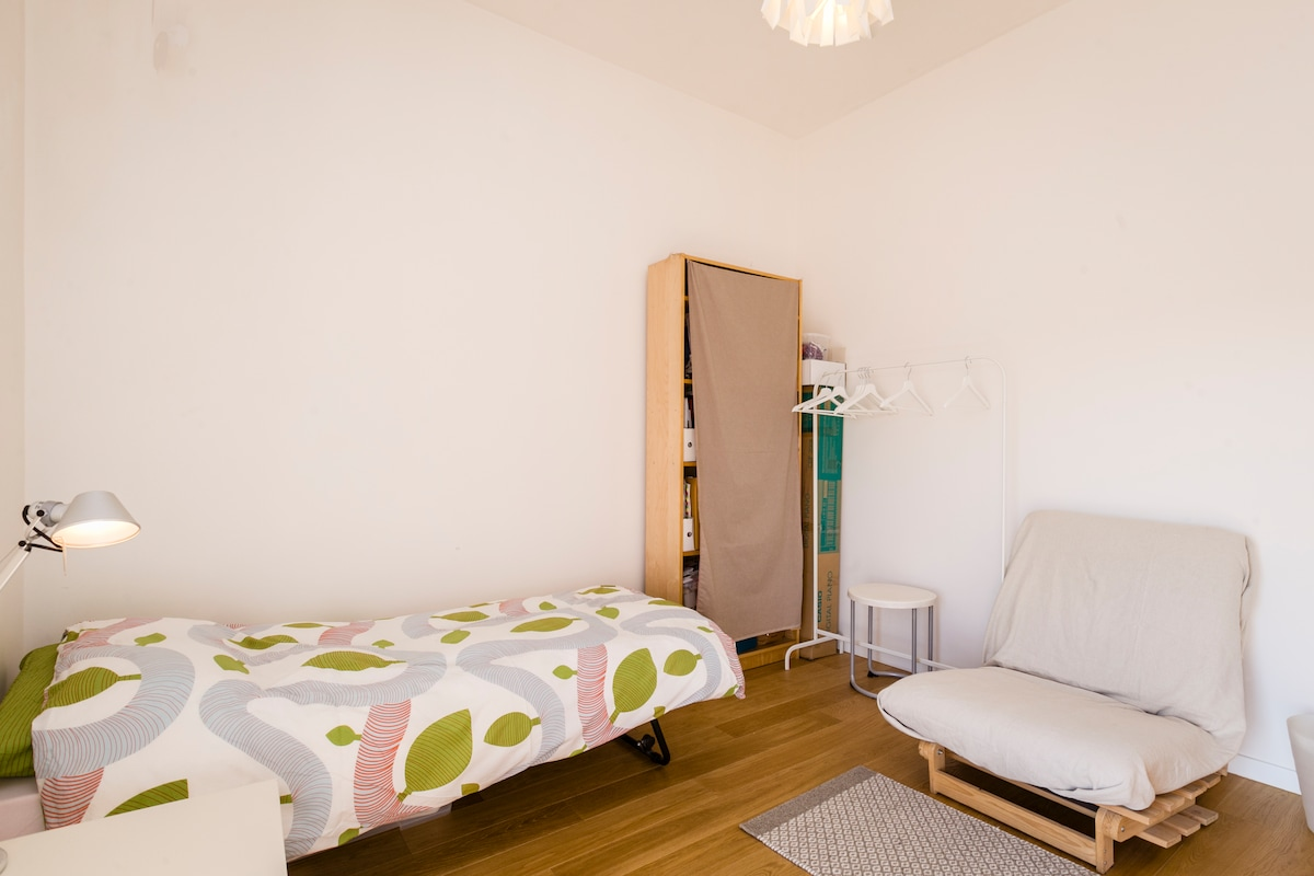 SINGLE BED, SOFA , DESK, SMALL TABLE, CLOTHS STAND, A BOTTLE OF WATER FOR YOU