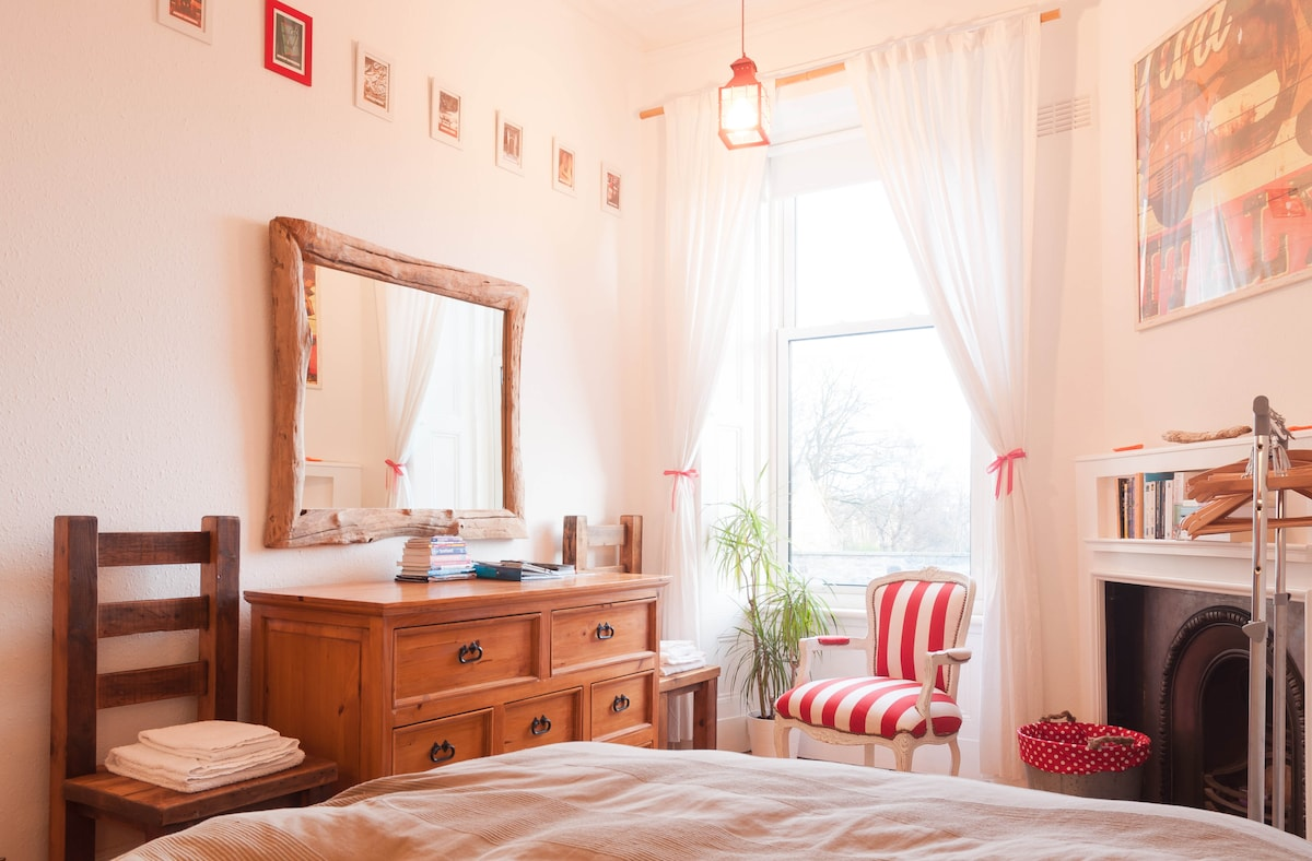 "Your private bedroom boasts lots of natural night, a king-size bed, chest of drawers, clothes hanging rail, a period fire-place and a reading corner featuring a ""Book Swap""."