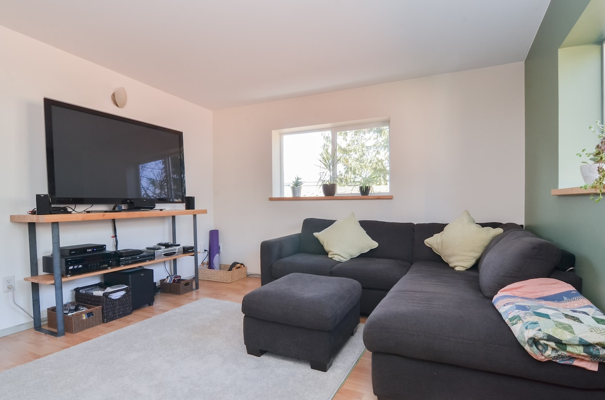 """Spacious living room with 60"""" TV, cable, HBO, and surround sound"""