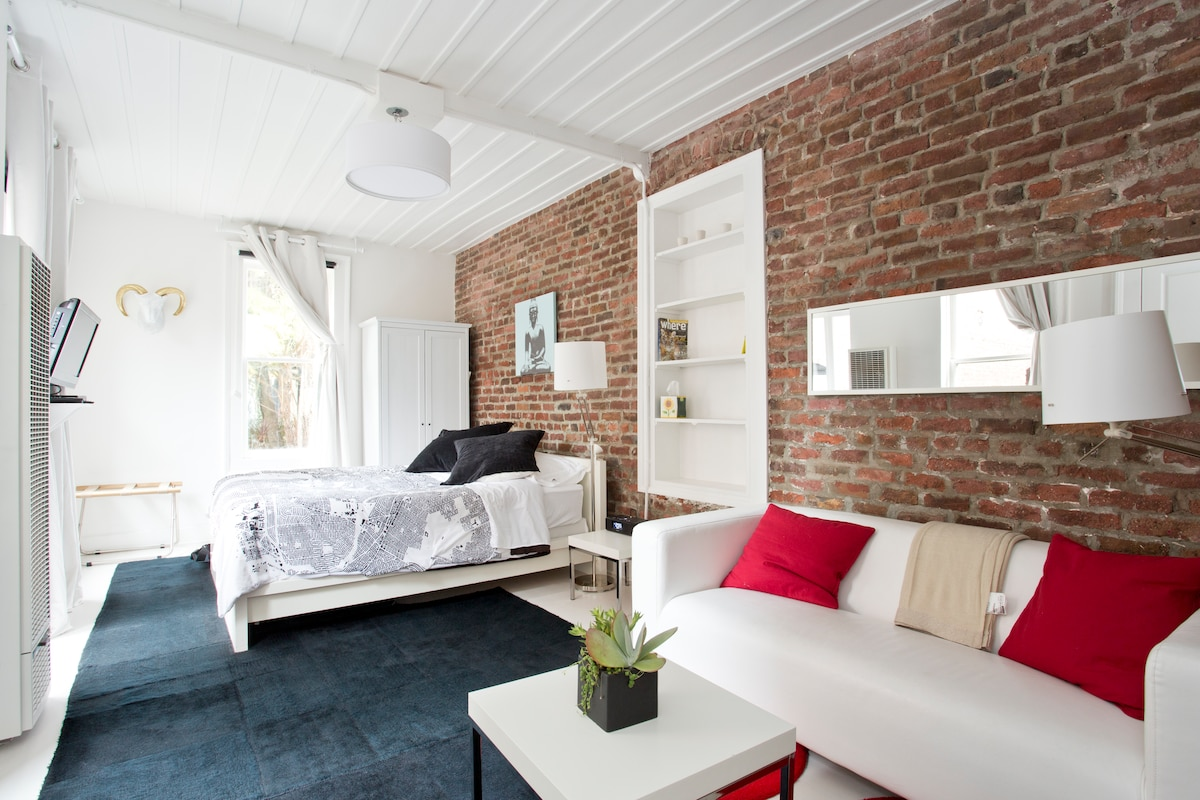 Historic turn-of-the-century exposed brick and modern furniture for your magical SF holiday!