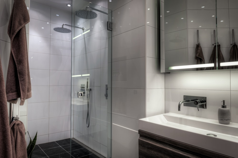 The large shared bathroom with showers