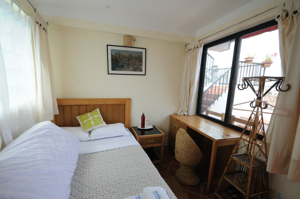 Small room, with table, view to Patan Durbar Square.