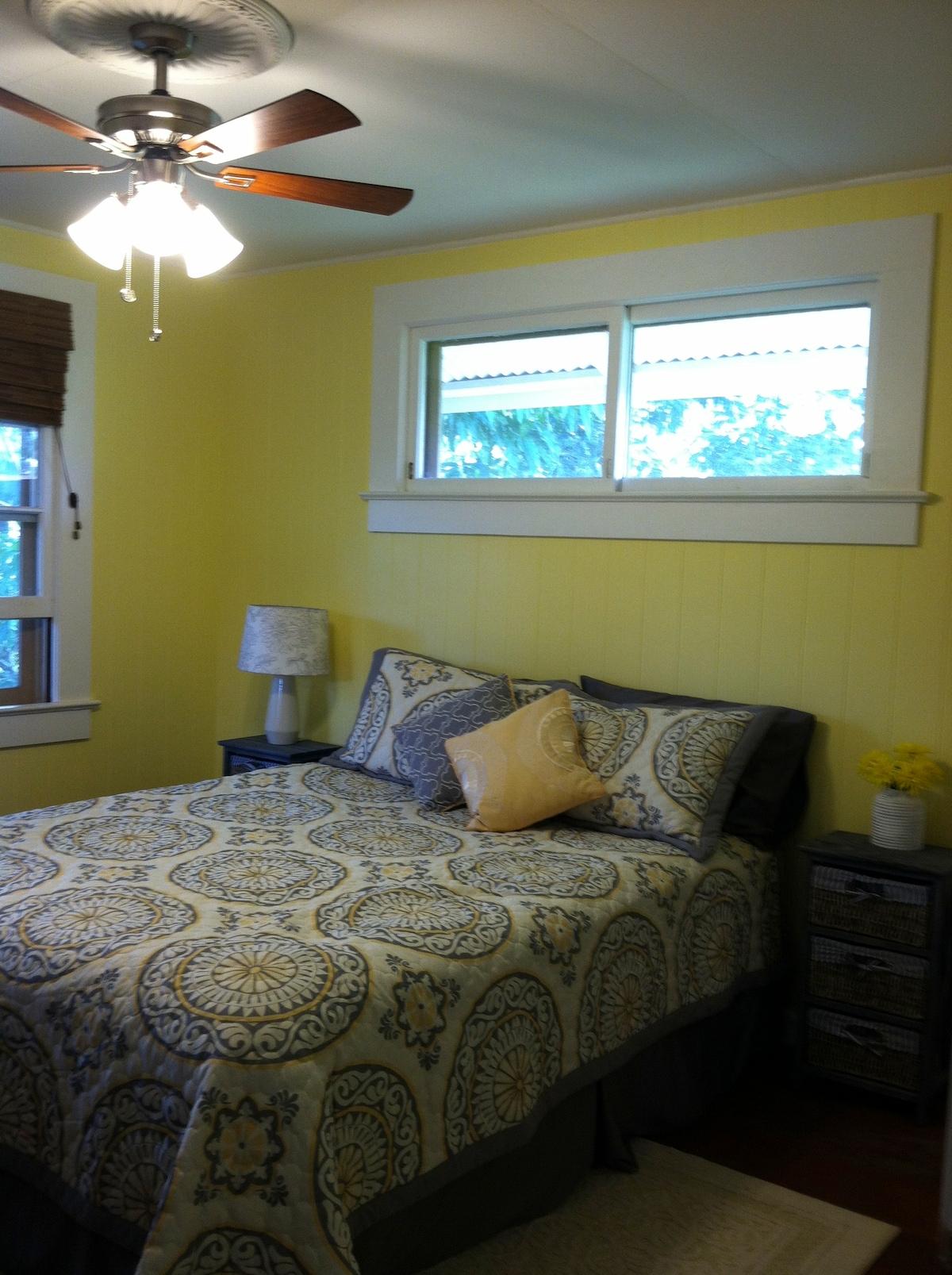 "Cozy corner bedroom snuggled into the rainforest ""backyard"""