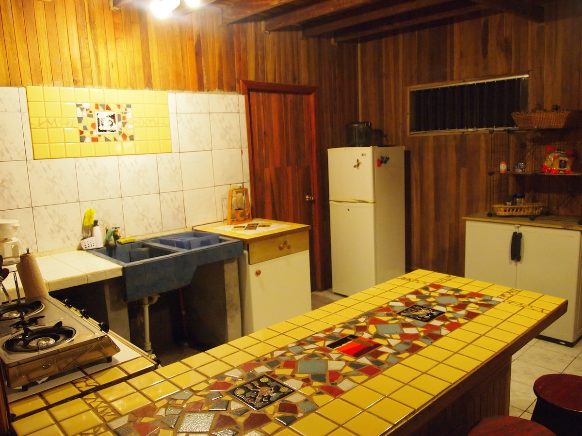 The fully-equipped kitchen with our custom tile work.