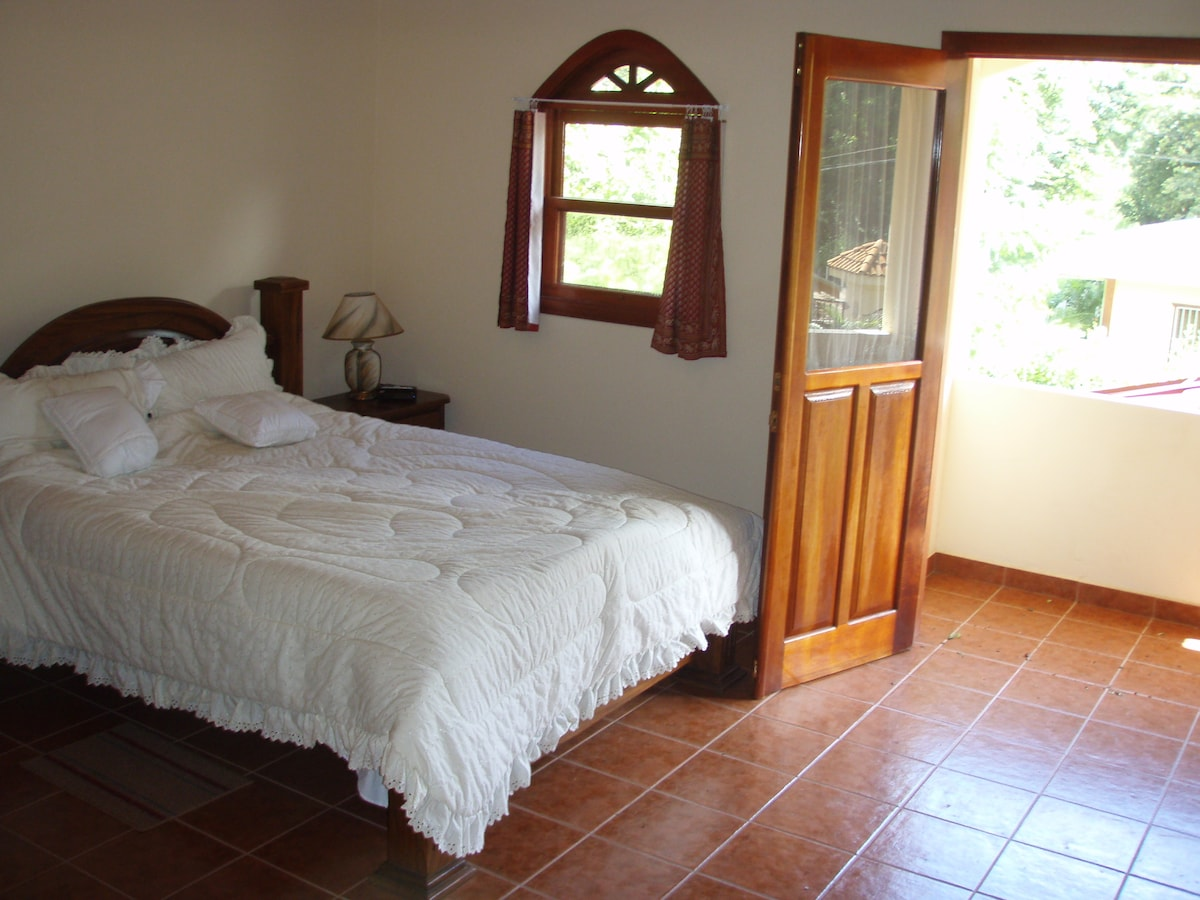 Mater bedroom, now a king size bed, private balcony and private bathroom as it looks out the balcony where the monkeys live.