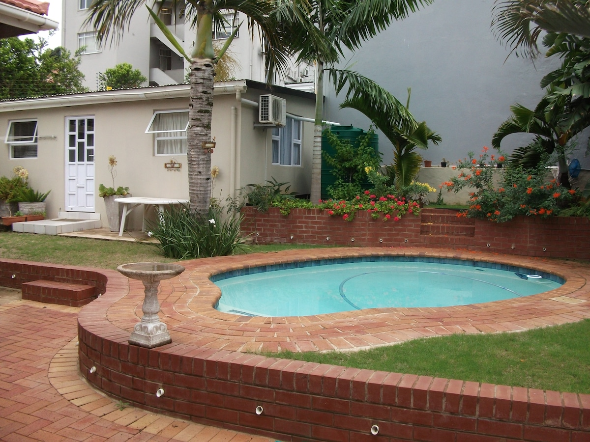 Setting of cottage in private and secure garden with pool.