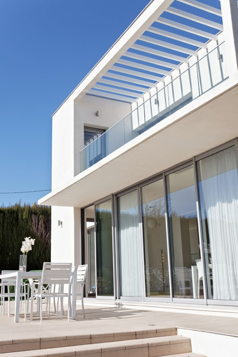 Glass doors and terrace outside the master bedroom.