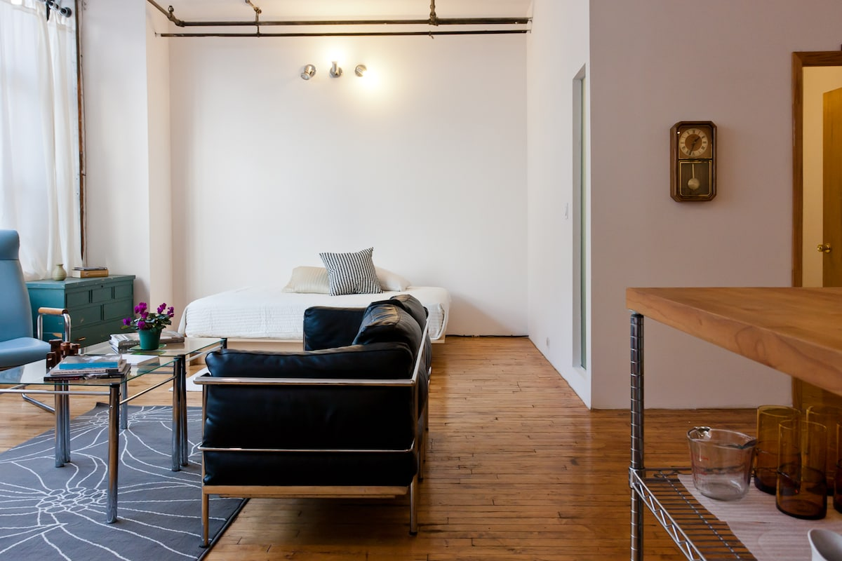 Lounge or sleep overnight on the platform bed in the living room alcove.