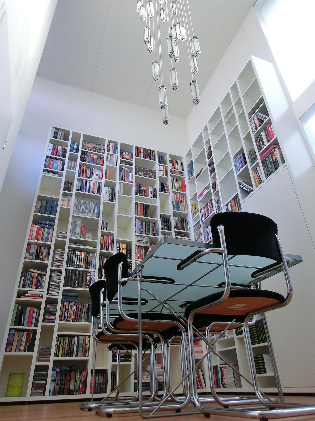 Entry hallway, 6 meters high, with 4-meters book case
