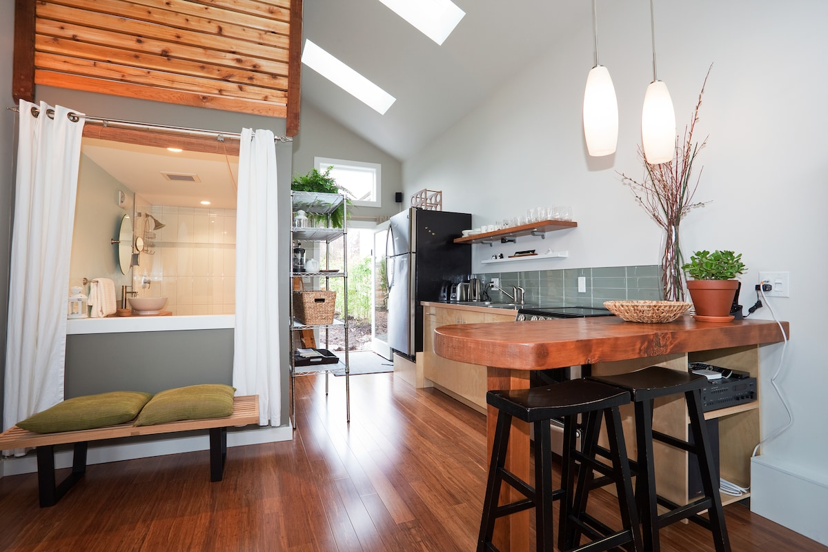 vaulted ceilings, natural light, eating bar and kitchen.