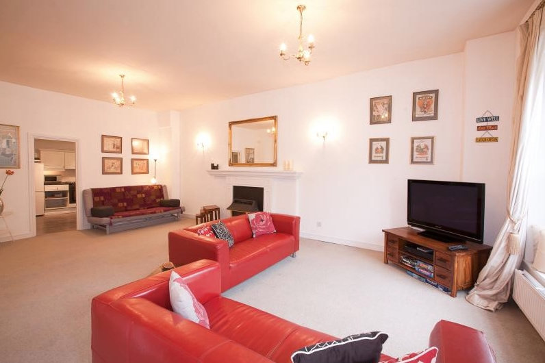 The spacious living area in Flat 3
