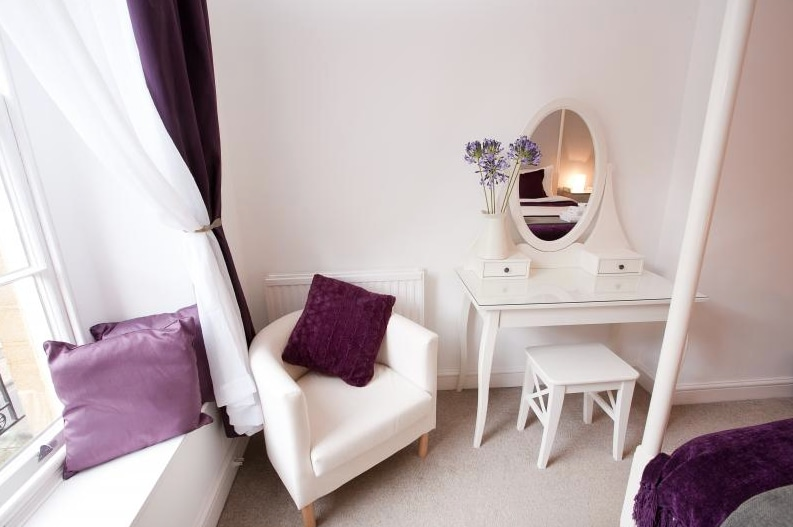A dressing table and armchair in the master bedroom