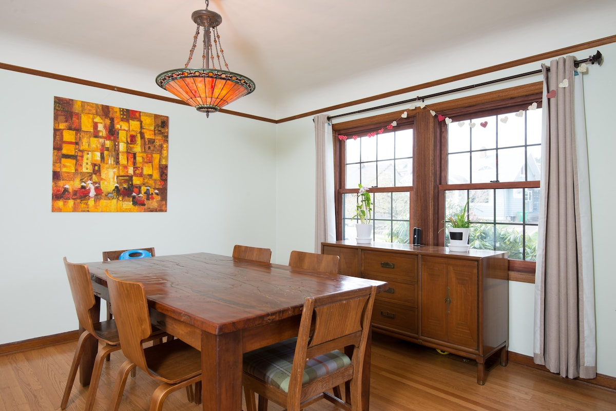 The dining table is made from Indian railroad ties. The painting is of Saigon. The windows open!